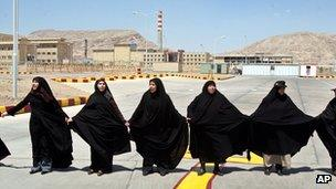 Iranian women hold hands outside the Isfahan uranium conversion facility (2005)