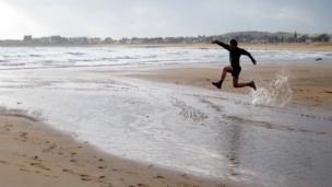 Jonathan running along Elie beach