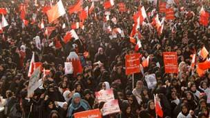Women attend the anti-government march just outside Manama