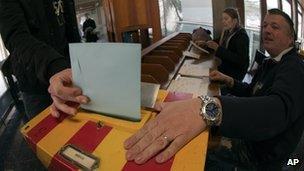 A man votes in Carouge, Switzerland