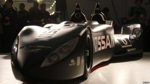 Nissan's new Deltawing race car is seen after it was unveiled in London. This frontal shot highlights the smooth shape of the car. Two driving seats at the back of the car stand tall, jutting out of the low vehicle.