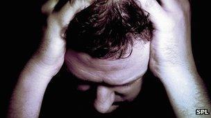 Man holding head