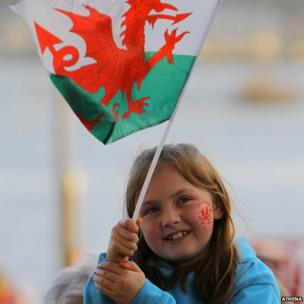 Fans wave flags as the team arrived at the Senedd