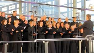 A choir kept the crowd entertained ahead of the Wales team's arrival