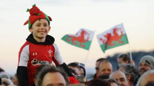 The Welsh Rugby Union says about 8,000 supporters turned up at Cardiff Bay
