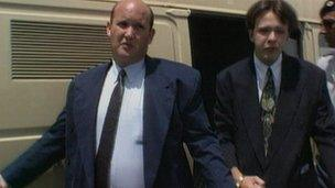Mr Mitchell and Mr Tozer leave prison van before court hearing in 1995