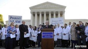 Doctors wearing white coats rally outside the US Supreme Court, 26 March 2012