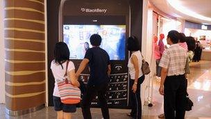 Shoppers are drawn to the large interactive display of the popular mobile handset Blackberry