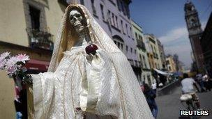 "A statue of ""Saint Death"" is seen in Mexico City March 7, 2012."