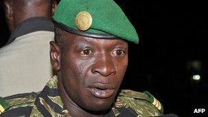 Malian junta leader captain Amadou Sanogo speaks after his meeting with Burkina Faso's Foreign Minister Djibril Bassole at the Kati military camp near Bamako on 31 March 2012