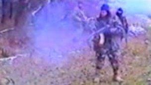 A Chechen fires a machine gun