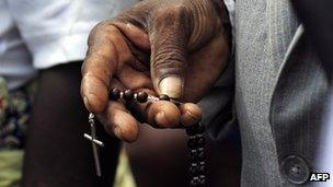 Angolan man with a crucifix during the Pope's visit to Luanda in 2009