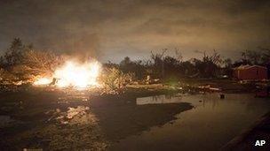 Fire burns in Wichita, Kansas, after a tornado strike late on Saturday 14 April