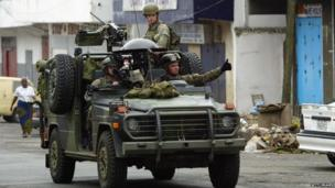 US Marines patrol the streets of Monrovia, 24 August 2003