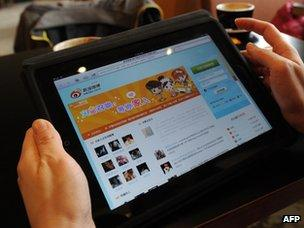 Woman looks at Chinese social media website