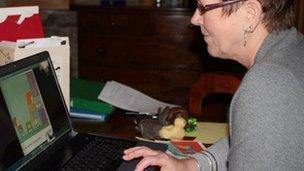 Jackie Barrow using Skype to read a story