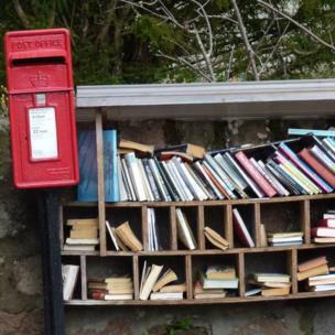 Letter box and an outdoor book shelf