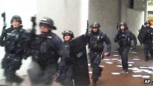 Armed police enter a building on Tottenham Court Road