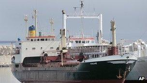 """The ship """"Lutfallah II"""" believed to be carrying three containers of weapons, is docked at a Lebanese navy base, in Beirut, Lebanon, on Saturday April 28, 2012."""