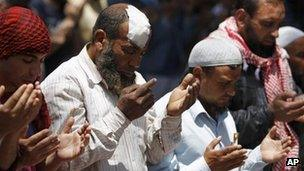 Supporters of Salafist preacher Hazem Abu Ismail pray outside the Egyptian defence ministry building in Cairo (29 April 2012)