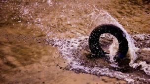 Tyre rolling through water