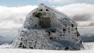 Emergency shelter on the summit of Ben Nevis covered in rime ice