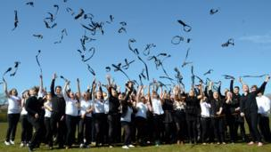 Sixth year pupils at Lochaber High School throw their ties in the air