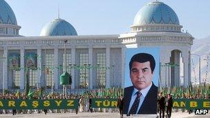 Participants of a parade carry a portrait of their President Saparmurat Niyazov as they celebrate the Turkmenistan's Independence Day in Ashgabat, 27 October 2005.