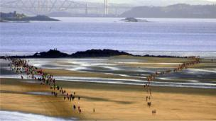 People run along the beach at Kinghorn in the Black Rock 5 race