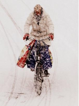 A person cycling through snow