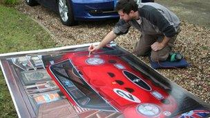 Chris Smart painting the garage cover