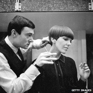 Clothes designer Mary Quant, one of the leading lights of the British fashion scene in the 1960's, having her hair cut by another fashion icon, hairdresser Vidal Sassoon.