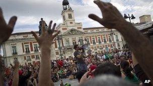 """People gather during a protest to mark the anniversary of the """"Indignados"""" movement at Puerta del Sol square in Madrid, Spain, on Sunday"""