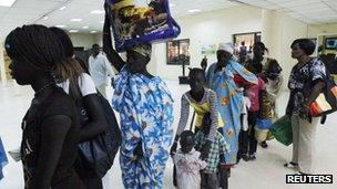 South Sudanese waiting to be flown back to their country arrive at Khartoum Airport May 14, 2012.