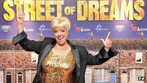 Julie Goodyear in front of Street of Dreams poster