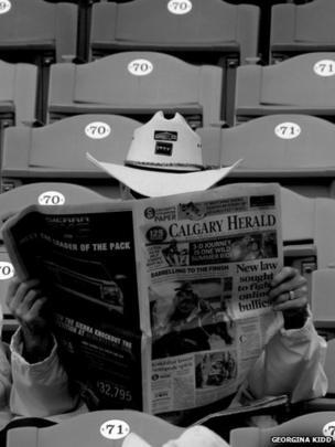 Man reading newspaper
