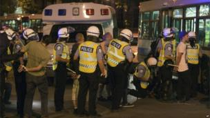 Police line up protesters who have been arrested during a demonstration against rising tuition fees in Montreal, Canada 24 May 2012