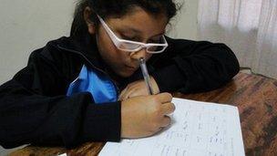 Xiomara doing her homework