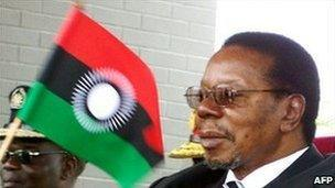 Malawi's President Bingu wa Mutharika waves the new flag at the launch of the new national flag on 7 August 2010