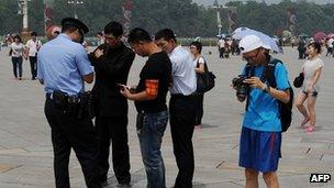 Police check people's papers in Tiananmen Square. 4 June 2012