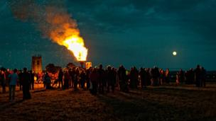 Villagers gathering for the lighting of the Jubilee beacon