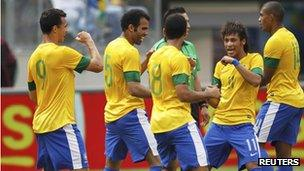 Brazil's players celebrate a goal in a friendly against Argentina on 9 June 2012