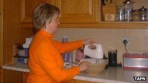 Sue Pallett using a food whisk