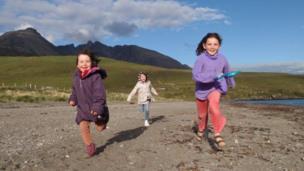 Isla, Julia and Sula running along the beach