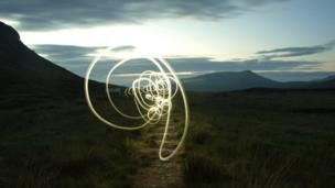 Torch light captured on a long exposure at sunset in the Highlands