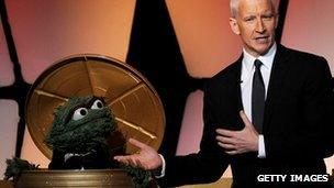 Anderson Cooper and Oscar the Grouch