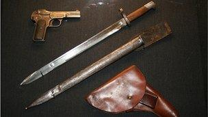 A pistol and knife owned by Yakov Yurovsky, leader of the execution squad
