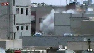 Amateur video purported to show artillery in Damascus suburb of Duma 26 June 2012