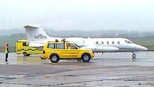 Plane arrives back