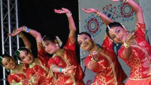 Dancers on stage at Glasgow Mela